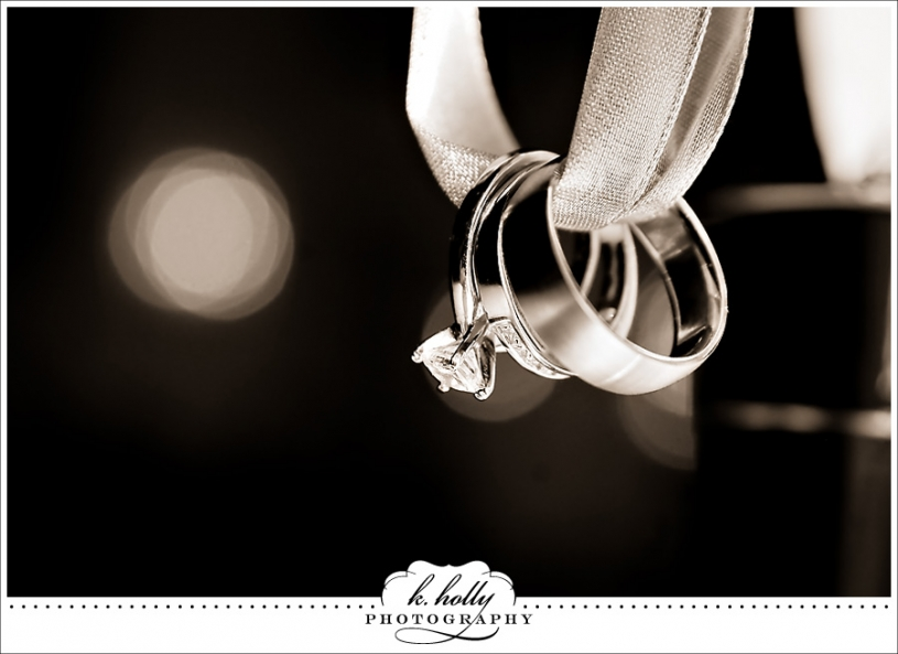 Wedding ring tied with ribbon